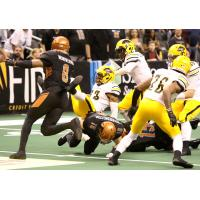 Davontae Merriweather of the Arizona Rattlers (left) rushes in to support Jarrod Harrington's tackle against the Tucson Sugar Skulls