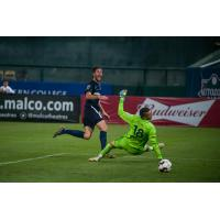 Elliot Collier of Memphis 901 sneaks a ball past Hartford Athletic