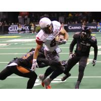 Arizona Rattlers make a tackle against the Sioux Falls Storm