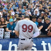 Aaron Judge of the New York Yankees, rehabbing with the Scranton/Wilkes-Barre RailRiders, signs autographs in Durham