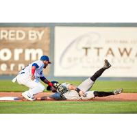 Ottawa Champions apply the tag vs. the Sussex County Miners