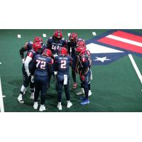 Washington Valor quarterback Arvell Nelson huddles up with his offense