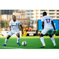 Memphis 901 FC midfielder Leston Paul (left)