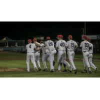 Walla Walla Sweets rush the field after clinching a playoff berth