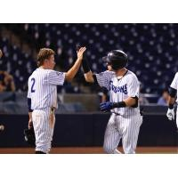 Diego Castillo (left) gives Donny Sands a high five following Sands' home run for the Tampa Tarpons