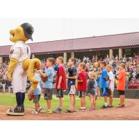 Kids with Fang, the mascot of the Wisconsin Timber Rattlers