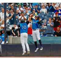 Jason Lopez and Pablo Olivares celebrate for the Tampa Tarpons