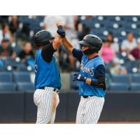 Michey Gasper and Diego Garcia celebrate for the Tampa Tarpons