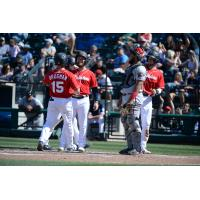 Jaycob Brugman of the Tacoma Rainiers receives congratulations after a home run
