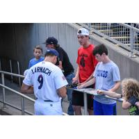 Trevor Larnach of the Pensacola Blue Wahoos signs autographs