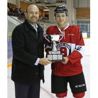 Vancouver Giants' Peter Toigo presents the Legends Cup to Tanner Brown