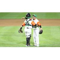 Long Island Ducks pitcher Seth Simmons gets a hug from catcher Ramon Cabrera