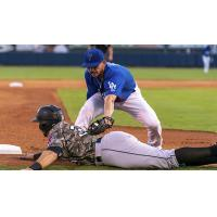 Connor Wong tags out a Travs runner at third in the Tulsa Drillers 6-1 victory over Arkansas