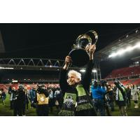 Seattle Sounders FC founding owner Joe Roth raises the MLS Cup following Seattle's victory over Toronto FC in 2016