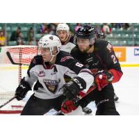 Vancouver Giants defenceman Dylan Plouffe fends off the Prince George Cougars