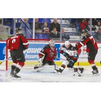 Kelowna Rockets left wing Dillon Hamaliuk pressures the Vancouver Giants