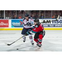 Kelowna Rockets left wing Mark Liwiski (right) against the Tri-City Americans