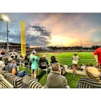 Fans enjoy the outfield view at Segra Stadium, home of the Fayetteville Woodpeckers
