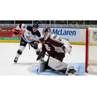 Peterborough Petes goaltender Hunter Jones faces Saginaw Spirit left wing Damien Giroux