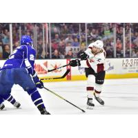 Cleveland Monsters center Ryan MacInnis takes a shot against the Syracuse Crunch