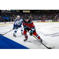 Kelowna Rockets left wing Mark Liwiski (right) vs. the Swift Current Broncos