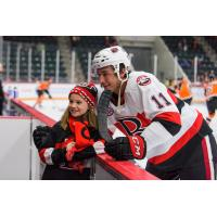 Belleville Senators left wing Vitaly Abramov poses with a young fan