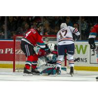 Kelowna Rockets goaltender Roman Basran smothers a shot against the Kamloops Blazers