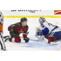 Vancouver Giants center Tristen Nielsen (left) vs. the Swift Current Broncos
