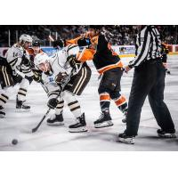 Lehigh Valley Phantoms forward Morgan Frost (right) battles the Hershey Bears