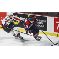 Saginaw Spirit right wing Cole Coskey (right) vs. the Windsor Spitfires