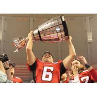 Calgary Stampeders punter Rob Maver lifts the Grey Cup