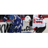 Binghamton Devils center Brett Seney (right) vs. the Syracuse Crunch