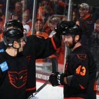 T.J. Brennan receives congratulations from his Lehigh Valley Phantoms teammates