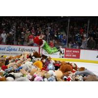Vancouver Giants in Teddy Bear Toss jersey dive into a bile of bears