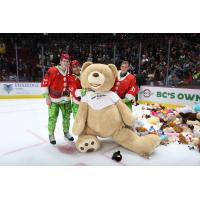 Vancouver Giants pose with a giant teddy bear
