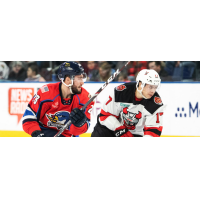 Binghamton Devils center Egor Sharangovich (right) vs. the Springfield Thunderbirds