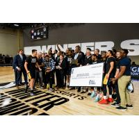 Salt Lake City Stars hold up the $100,000 check from winning the MGM Resorts NBA G League Winter Showcase Tournament