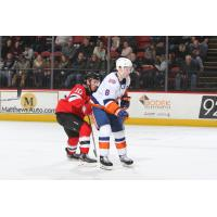 Binghamton Devils center Ben Street (left) vs. the  Bridgeport Sound Tigers