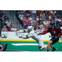 Vancouver Warriors forward Jordan McBride lunges to take a shot against the Colorado Mammoth