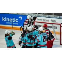Columbus River Dragons celebrate against the Port Huron Prowlers