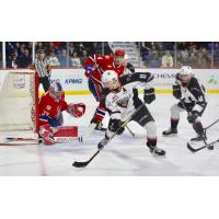 Vancouver Giants right wing Tyler Presiuso handles the puck vs. the Spokane Chiefs