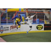 San Diego Sockers and Harrisburg Heat fight for possession
