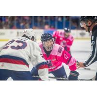 Tulsa Oilers left wing Danny Moyniham faces off with the Kalamazoo Wings