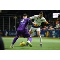 Danny DiPrima of the Harrisburg Heat defends against the Tacoma Stars