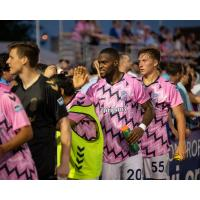 Forward Madison FC defender Josiah Trimmingham