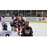 Port Huron Prowlers exchange greetings with the Mentor Ice Breakers
