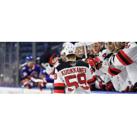 Janne Kuokkanen along the Binghamton Devils bench