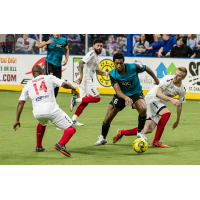 Leo Gibson of the Kansas City Comets (left) eyes the ball against the St. Louis Ambush