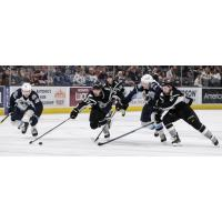 #37 Jake Walman and #8 Joey LaLeggia of the San Antonio Rampage race the Milwaukee Admirals for a loose puck
