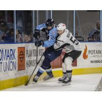 Andreas Borgman of the San Antonio Rampage (right) throws a hit on Milwaukee Admirals defenseman Ben Harpur